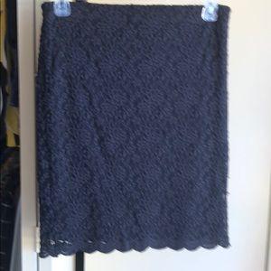Adorable black stretch lace mini skirt